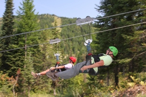 Renee and I zipping through the trees